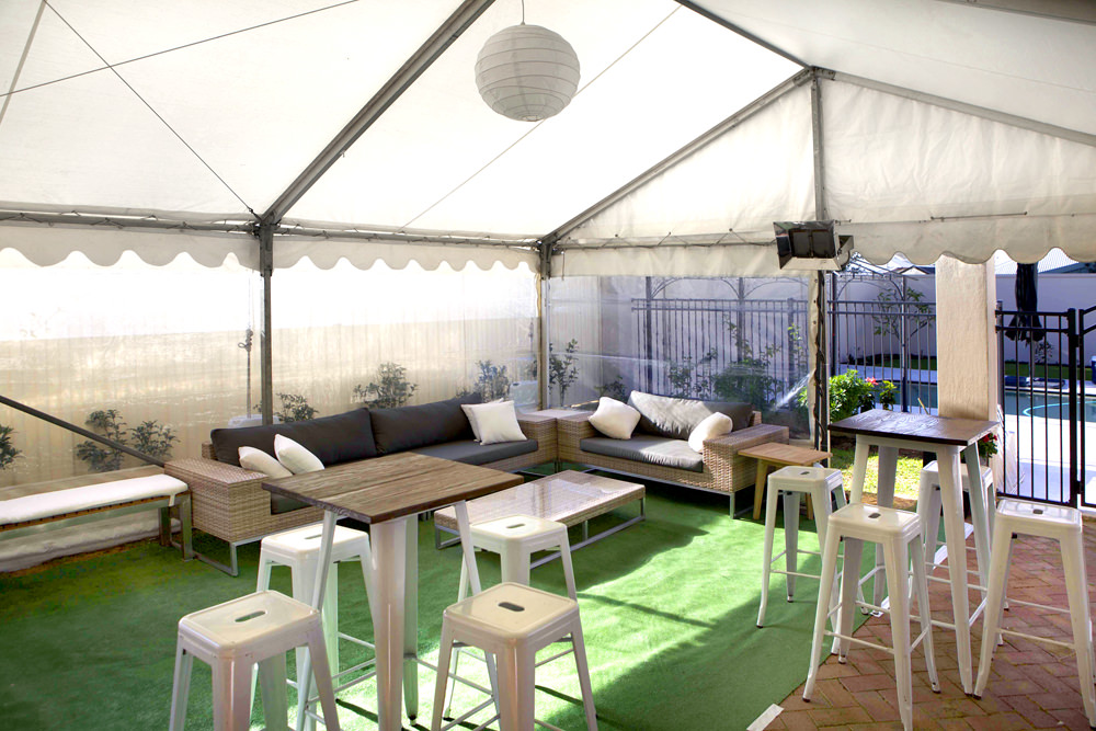 Party marquee with bar stool and table